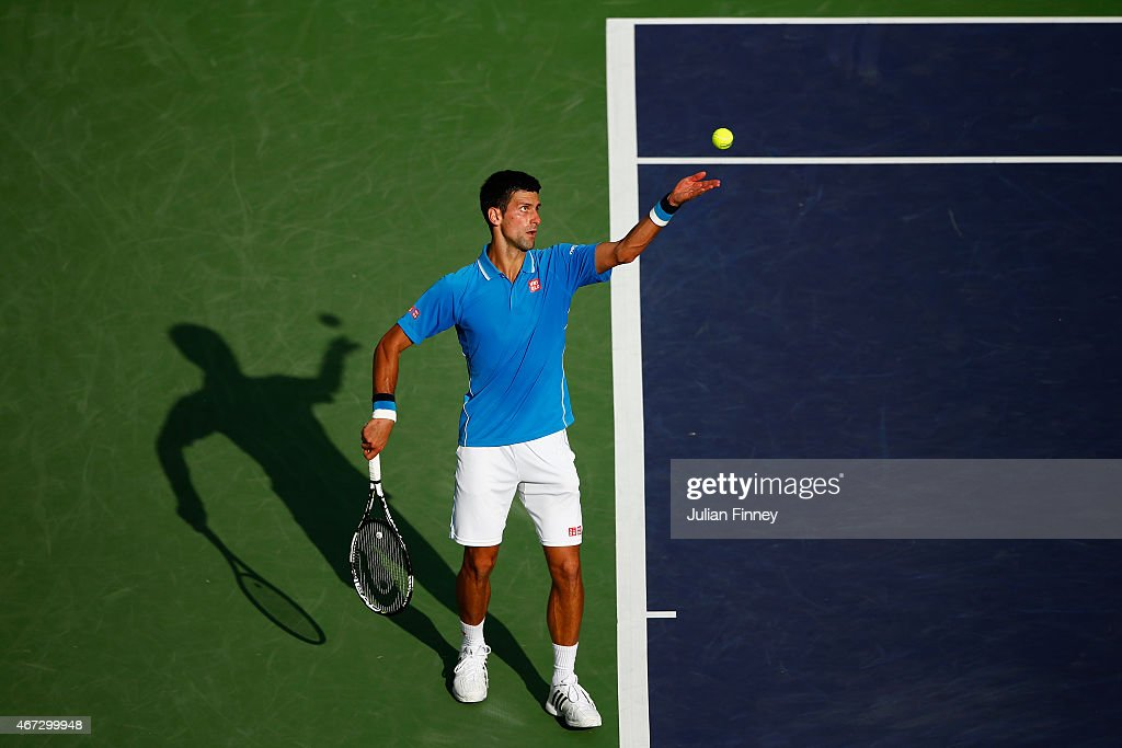 Novak Djokovic of Serbia in action against Roger Federer of Switzerland in the final during day fourteen of the BNP Paribas Open tennis at the Indian...