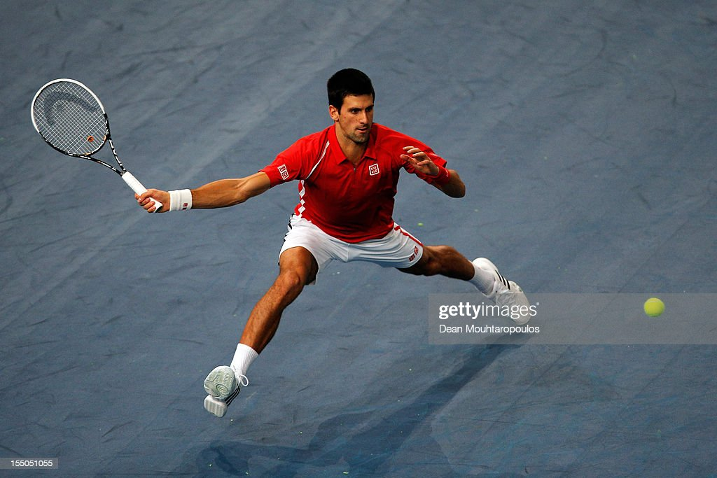 <a gi-track='captionPersonalityLinkClicked' href=/galleries/search?phrase=Novak+Djokovic&family=editorial&specificpeople=588315 ng-click='$event.stopPropagation()'>Novak Djokovic</a> of Serbia in action against Sam Querrey of USA during day 3 of the BNP Paribas Masters at Palais Omnisports de Bercy on October 31, 2012 in Paris, France.