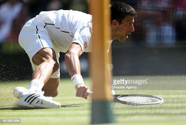 Novak Djokovic of Serbia in action during his Gentlemen's Singles semifinal match against Grigor Dimitrov of Bulgaria on day eleven of the Wimbledon...