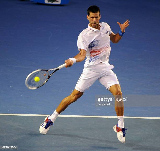 Novak Djokovic of Serbia in action in during his men's singles semi final against Andy Murray of Great Britain on day twelve of the 2012 Australian...