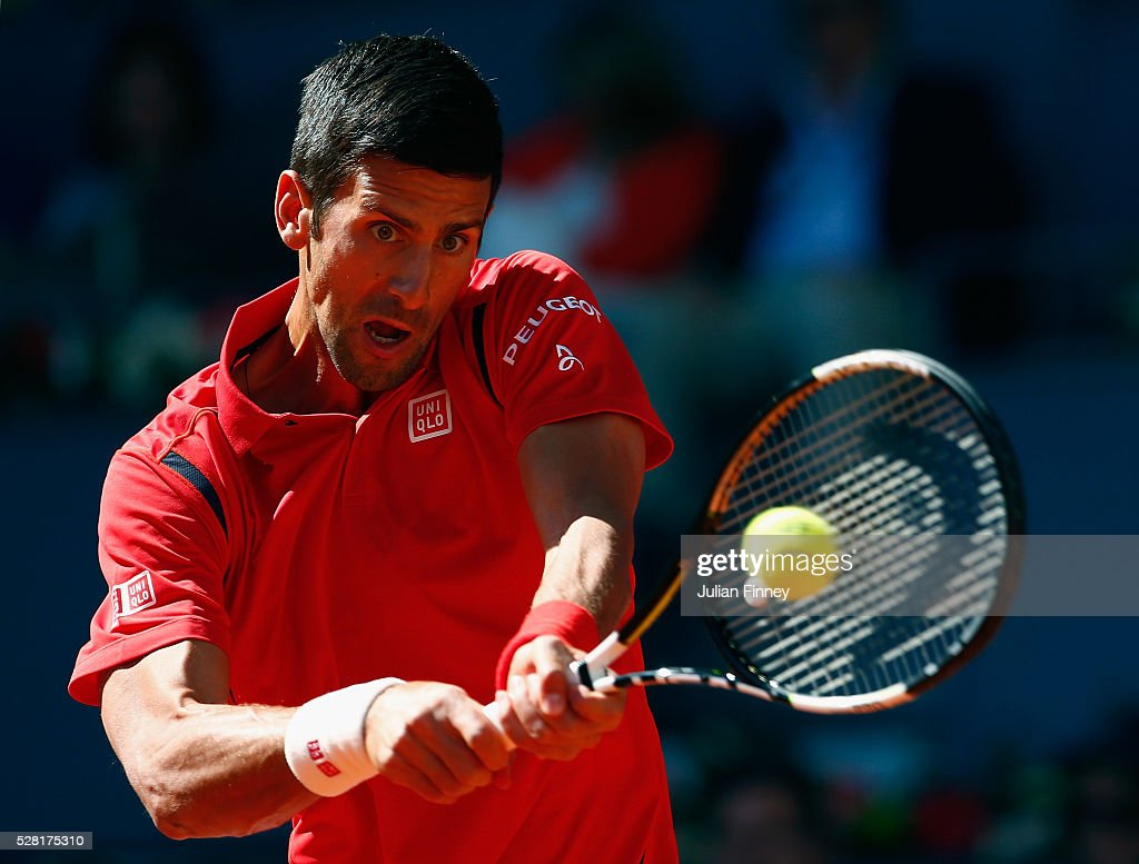 <a gi-track='captionPersonalityLinkClicked' href=/galleries/search?phrase=Novak+Djokovic&family=editorial&specificpeople=588315 ng-click='$event.stopPropagation()'>Novak Djokovic</a> of Serbia in action in his match against Borna Coric of Croatia during day five of the Mutua Madrid Open tennis tournament at the Caja Magica on May 04, 2016 in Madrid, Spain.