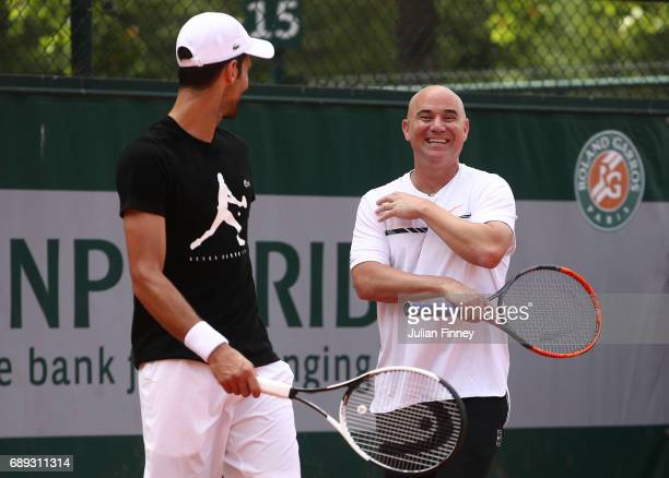 Novak Djokovic of Serbia in discussion with coach Andre Agassi during practice on day one of the 2017 French Open at Roland Garros on May 28 2017 in...