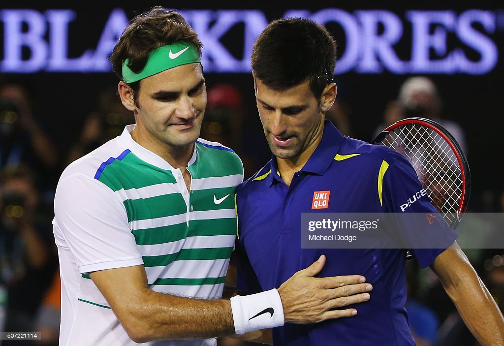 Novak Djokovic of Serbia is congratulated after winning in his semi final match against Roger Federer (L) of Switzerland during day 11 of the 2016 Australian Open at Melbourne Park on January 28, 2016 in Melbourne, Australia.