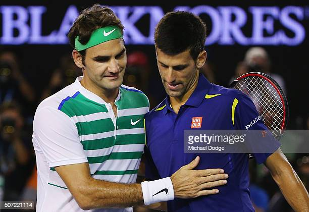 Novak Djokovic of Serbia is congratulated after winning in his semi final match against Roger Federer of Switzerland during day 11 of the 2016...