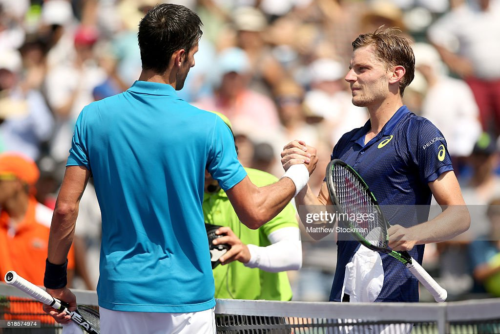 <a gi-track='captionPersonalityLinkClicked' href=/galleries/search?phrase=Novak+Djokovic&family=editorial&specificpeople=588315 ng-click='$event.stopPropagation()'>Novak Djokovic</a> of Serbia is congratulated by <a gi-track='captionPersonalityLinkClicked' href=/galleries/search?phrase=David+Goffin&family=editorial&specificpeople=2291768 ng-click='$event.stopPropagation()'>David Goffin</a> of Belgium after their match during the semifinals of the Miami Open presented by Itau at Crandon Park Tennis Center on April 1, 2016 in Key Biscayne, Florida.