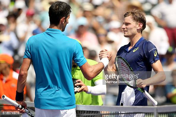 Novak Djokovic of Serbia is congratulated by David Goffin of Belgium after their match during the semifinals of the Miami Open presented by Itau at...