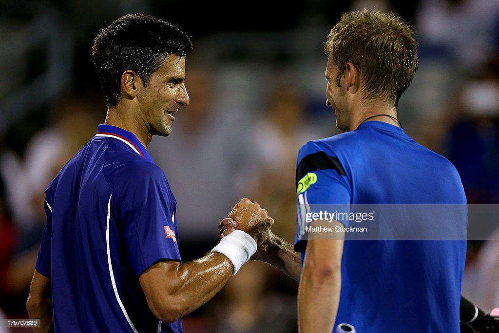 <a gi-track='captionPersonalityLinkClicked' href=/galleries/search?phrase=Novak+Djokovic&family=editorial&specificpeople=588315 ng-click='$event.stopPropagation()'>Novak Djokovic</a> of Serbia is congratulated by <a gi-track='captionPersonalityLinkClicked' href=/galleries/search?phrase=Florian+Mayer&family=editorial&specificpeople=206516 ng-click='$event.stopPropagation()'>Florian Mayer</a> of Germany after their match during the Rogers Cup at Uniprix Stadium on August 6, 2013 in Montreal, Quebec, Canada.