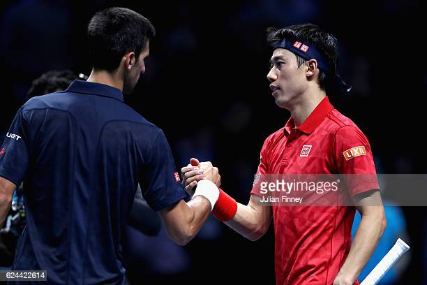 Novak Djokovic of Serbia is congratulated by Kei Nishikori of Japan after winning their men's singles semi final on day seven of the ATP World Tour...