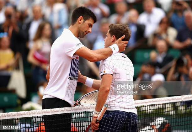 Novak Djokovic of Serbia is congratulated on victory by his opponant Diego Shwartzman of Argentina following the mens singles third round match on...