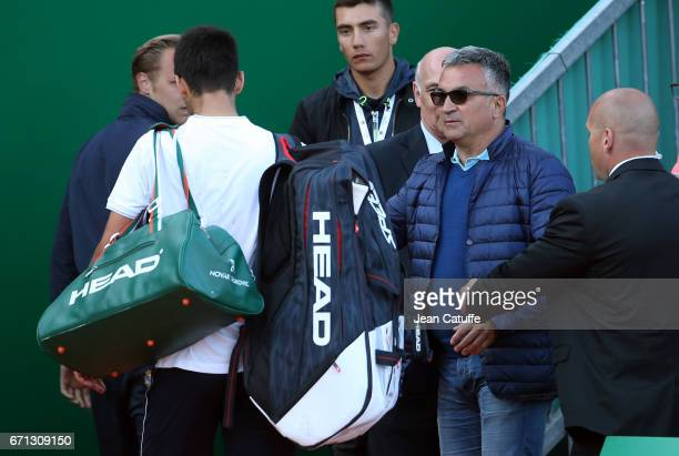 Novak Djokovic of Serbia is consoled by his father Srdan Djokovic while leaving the court after losing against David Goffin of Belgium in quarter...