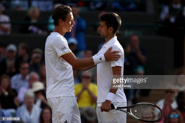 Novak Djokovic of Serbia is consoled by Tomas Berdych of The Czech Republic as he retires injured during the Gentlemen's Singles quarter final match...