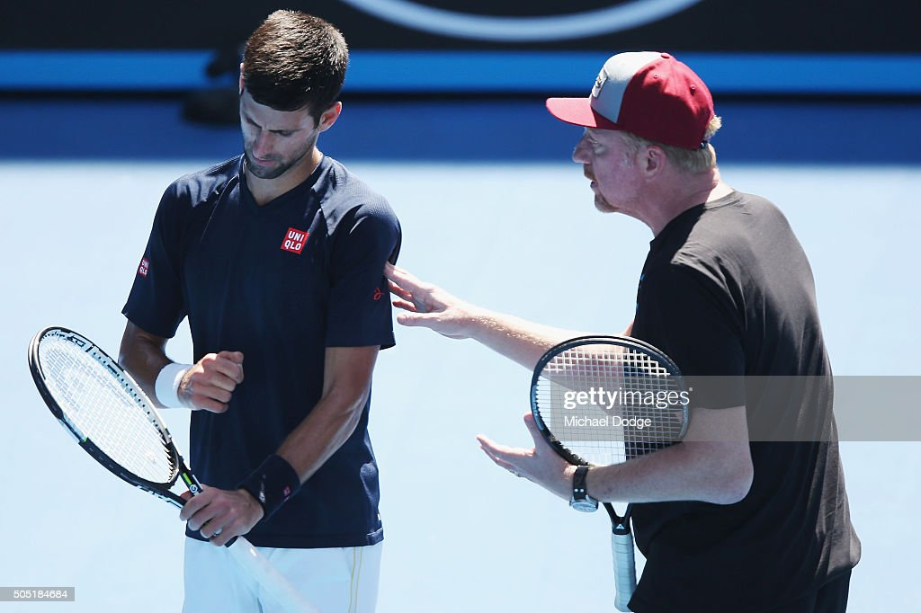 Novak Djokovic of Serbia is nudged by coach Boris Becker who talks to him during a practice session ahead of the 2016 Australian Open at Melbourne Park on January 16, 2016 in Melbourne, Australia.