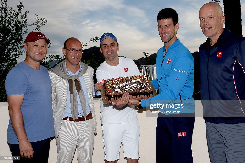 <a gi-track='captionPersonalityLinkClicked' href=/galleries/search?phrase=Novak+Djokovic&family=editorial&specificpeople=588315 ng-click='$event.stopPropagation()'>Novak Djokovic</a> of Serbia is presented a cake by coach Marian Vajda, Edoardo Artaldi, Sasa Jezdic and Gebhard Phil-Gritsch commemorating his 50th tournament win after defeating Roger Federer of Switzerland during the final on day fourteen of the BNP Paribas Open at the Indian Wells Tennis Garden on March 22, 2015 in Indian Wells, California.