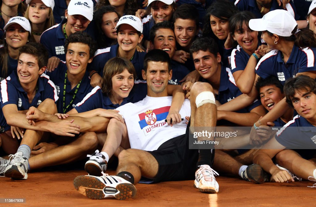 Novak Djokovic of Serbia is surrounded by ball boys and girls as he enjoys his win over Rafael Nadal of Spain after the final during day nine of the Mutua Madrilena Madrid Open Tennis on May 8, 2011 in Madrid, Spain.