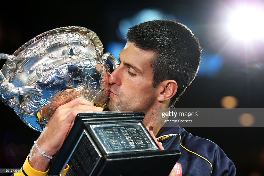 <a gi-track='captionPersonalityLinkClicked' href=/galleries/search?phrase=Novak+Djokovic&family=editorial&specificpeople=588315 ng-click='$event.stopPropagation()'>Novak Djokovic</a> of Serbia kisses the Norman Brookes Challenge Cup after winning his men's final match against Andy Murray of Great Britain during day fourteen of the 2013 Australian Open at Melbourne Park on January 27, 2013 in Melbourne, Australia.