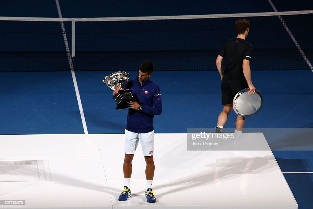 <a gi-track='captionPersonalityLinkClicked' href=/galleries/search?phrase=Novak+Djokovic&family=editorial&specificpeople=588315 ng-click='$event.stopPropagation()'>Novak Djokovic</a> of Serbia kisses the Norman Brookes Challenge Cup after winning the Men's Singles Final over <a gi-track='captionPersonalityLinkClicked' href=/galleries/search?phrase=Andy+Murray+-+Tennis+Player&family=editorial&specificpeople=200668 ng-click='$event.stopPropagation()'>Andy Murray</a> of Great Britain during day 14 of the 2016 Australian Open at Melbourne Park on January 31, 2016 in Melbourne, Australia.