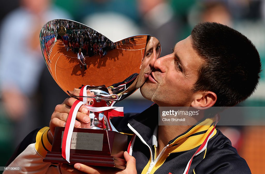 <a gi-track='captionPersonalityLinkClicked' href=/galleries/search?phrase=Novak+Djokovic&family=editorial&specificpeople=588315 ng-click='$event.stopPropagation()'>Novak Djokovic</a> of Serbia kisses the trophy after his straight sets victory against Rafael Nadal of Spain in their final match during day eight of the ATP Monte Carlo Masters,at Monte-Carlo Sporting Club on April 21, 2013 in Monte-Carlo, Monaco.
