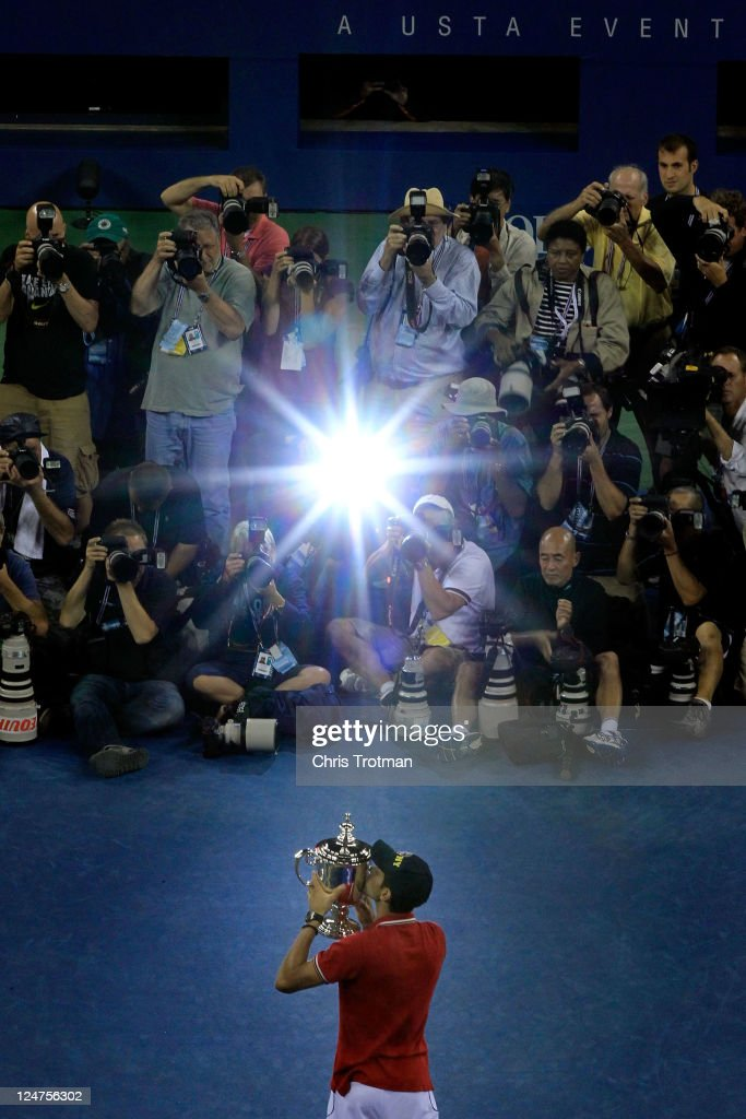 <a gi-track='captionPersonalityLinkClicked' href=/galleries/search?phrase=Novak+Djokovic&family=editorial&specificpeople=588315 ng-click='$event.stopPropagation()'>Novak Djokovic</a> of Serbia kisses the trophy as he celebrates defeating Rafael Nadal of Spain during the Men's Final on Day Fifteen of the 2011 US Open at the USTA Billie Jean King National Tennis Center on September 12, 2011 in the Flushing neighborhood of the Queens borough of New York City.