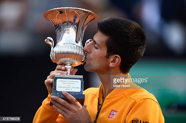 Novak Djokovic of Serbia kisses the Winner's Trophy after his victory over Roger Federer of Switzerland in the Men's Singles Final on Day Eight of...