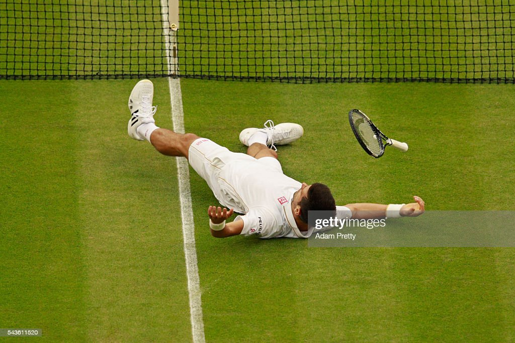 <a gi-track='captionPersonalityLinkClicked' href=/galleries/search?phrase=Novak+Djokovic&family=editorial&specificpeople=588315 ng-click='$event.stopPropagation()'>Novak Djokovic</a> of Serbia lays on the floor after playing a shot during the Men's Singles second round match against Adrian Mannarino of France on day three of the Wimbledon Lawn Tennis Championships at the All England Lawn Tennis and Croquet Club on June 29, 2016 in London, England.