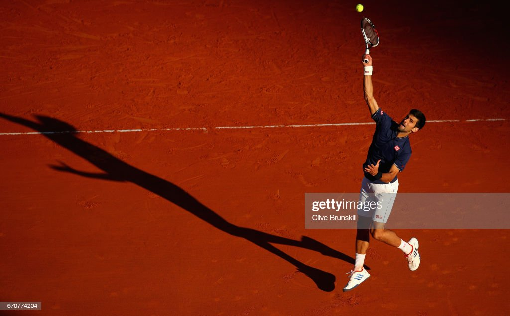 Novak Djokovic of Serbia leaps into the air to play a smash against Pablo Carreno Busta of Spain in his third round match on day five of the Monte Carlo Rolex Masters at Monte-Carlo Sporting Club on April 20, 2017 in Monte-Carlo, Monaco.