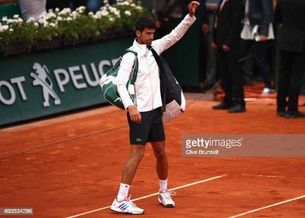 Novak Djokovic of Serbia leaves the court following defeat in the mens singles quarter finals match against Dominic Thiem of Austria on day eleven of...