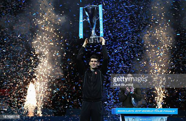 Novak Djokovic of Serbia lifts the trophy after his men's singles final match against Rafael Nadal of Spain during day eight of the Barclays ATP...