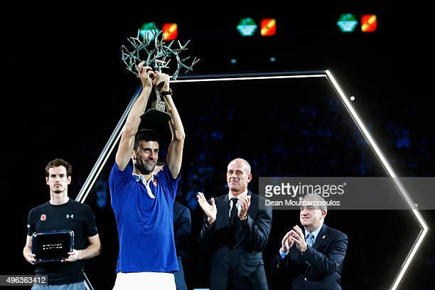 Novak Djokovic of Serbia lifts the trophy after victory against Andy Murray of Great Britain after their Mens Final match during Day 7 of the BNP...