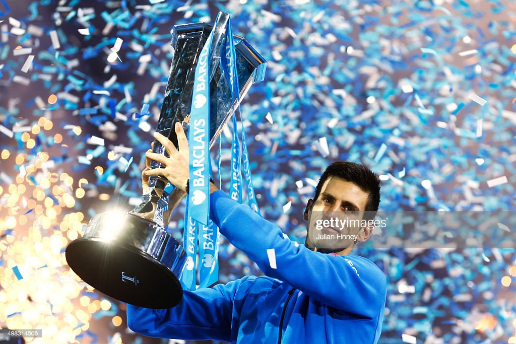 <a gi-track='captionPersonalityLinkClicked' href=/galleries/search?phrase=Novak+Djokovic&family=editorial&specificpeople=588315 ng-click='$event.stopPropagation()'>Novak Djokovic</a> of Serbia lifts the trophy following his victory during the men's singles final against Roger Federer of Switzerland on day eight of the Barclays ATP World Tour Finals at the O2 Arena on November 22, 2015 in London, England.