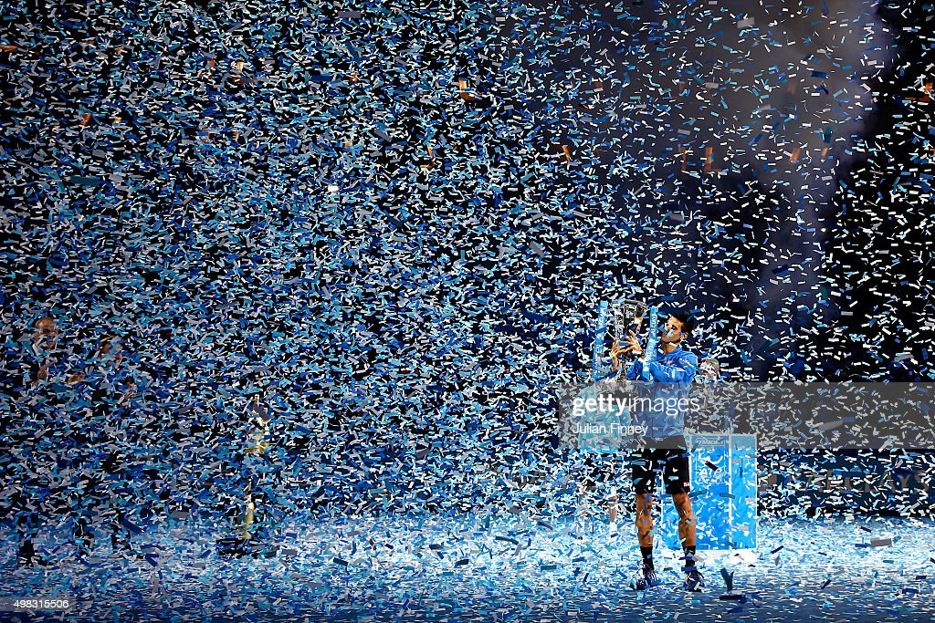 Novak Djokovic of Serbia lifts the trophy following his victory during the men's singles final against Roger Federer of Switzerland on day eight of the Barclays ATP World Tour Finals at the O2 Arena on November 22, 2015 in London, England.