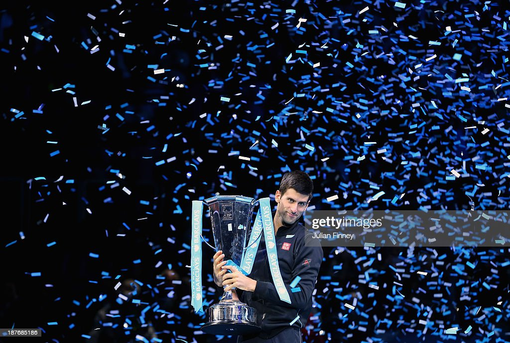 Novak Djokovic of Serbia lifts the winners trophy after defeating Rafael Nadal of Spain after the men's singles final match against during day eight...