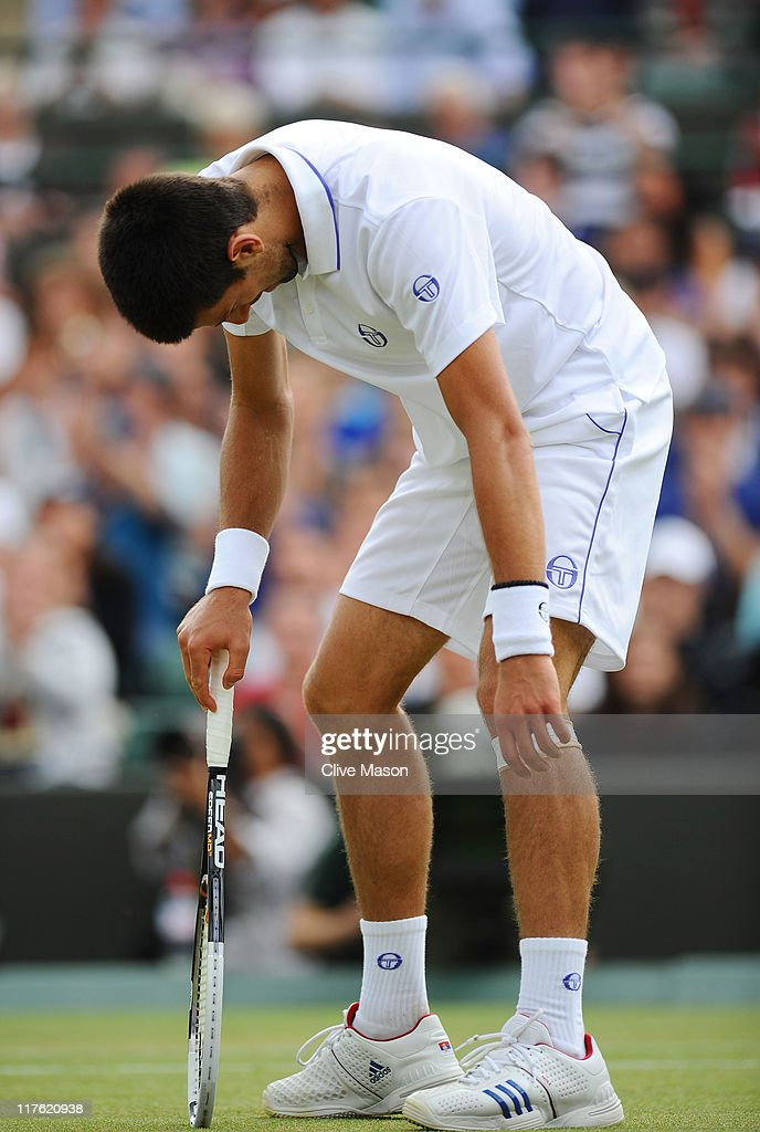 Novak Djokovic of Serbia looks dejected during his quarterfinal round match against Bernard Tomic of Australia on Day Nine of the Wimbledon Lawn Tennis Championships at the All England Lawn Tennis and Croquet Club on June 29, 2011 in London, England.