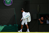 Novak Djokovic of Serbia looks dejected following defeat in the Men's Singles third round match against Sam Querrey of The United States on day six...