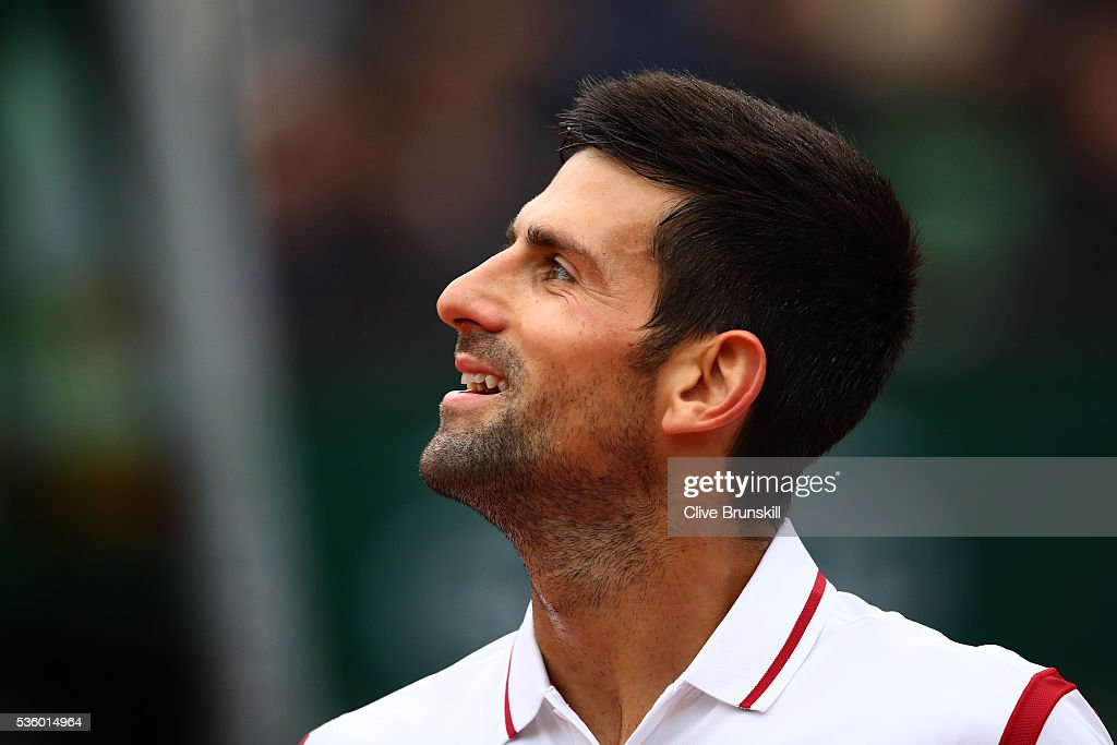 <a gi-track='captionPersonalityLinkClicked' href=/galleries/search?phrase=Novak+Djokovic&family=editorial&specificpeople=588315 ng-click='$event.stopPropagation()'>Novak Djokovic</a> of Serbia looks on during the Men's Singles fourth round match against Roberto Bautista Agut of Spain on day ten of the 2016 French Open at Roland Garros on May 31, 2016 in Paris, France.