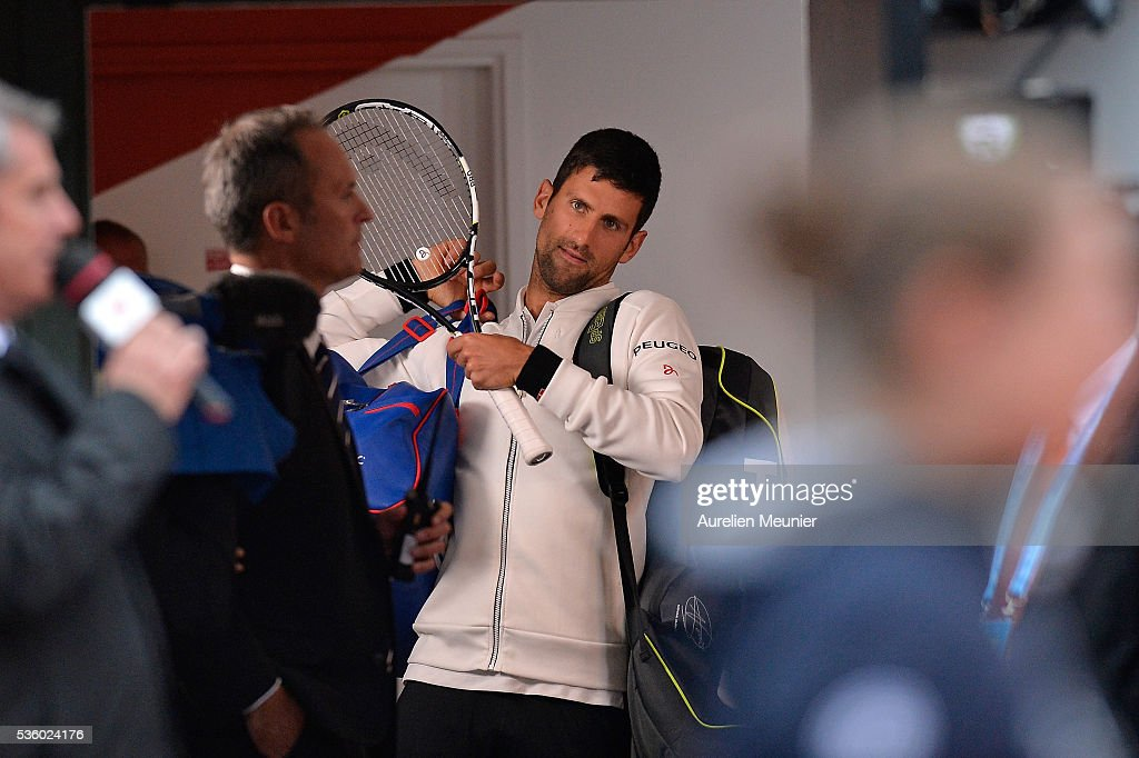 Novak Djokovic of Serbia looks on during the rain break during his men's singles fourth round match against Roberto Bautista Agut of Spain on day ten of the 2016 French Open at Roland Garros on May 31, 2016 in Paris, France.