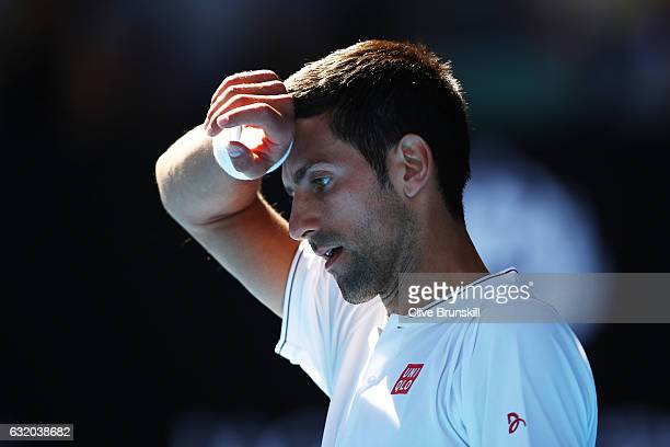 Novak Djokovic of Serbia looks on in his second round match against Denis Istomin of Uzbekistan on day four of the 2017 Australian Open at Melbourne...