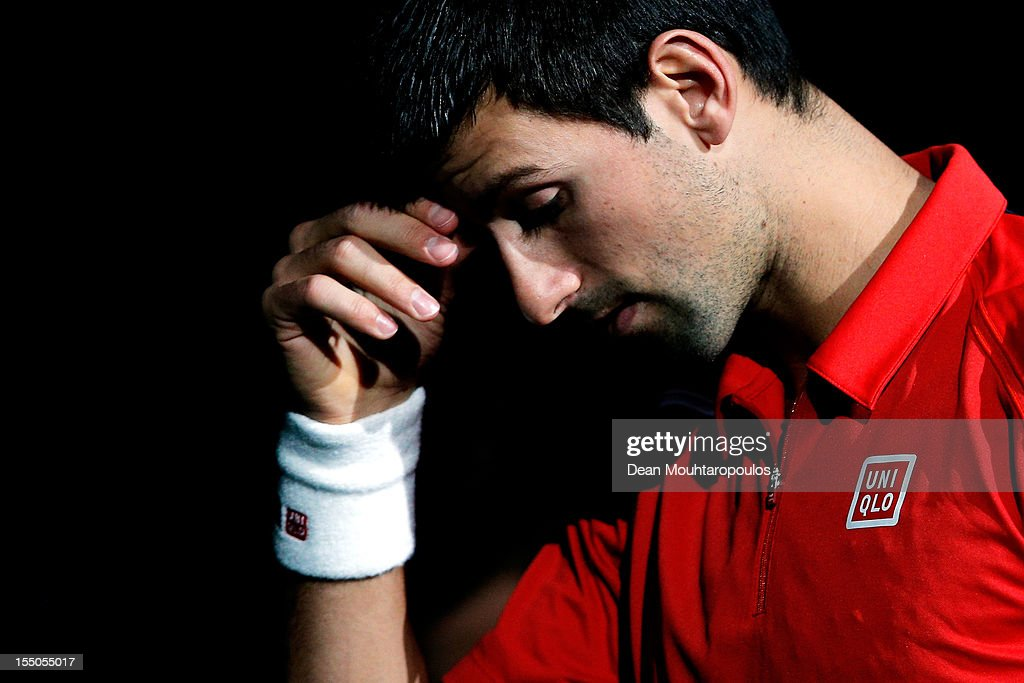 <a gi-track='captionPersonalityLinkClicked' href=/galleries/search?phrase=Novak+Djokovic&family=editorial&specificpeople=588315 ng-click='$event.stopPropagation()'>Novak Djokovic</a> of Serbia looks on prior to his match against Sam Querrey of USA during day 3 of the BNP Paribas Masters at Palais Omnisports de Bercy on October 31, 2012 in Paris, France.