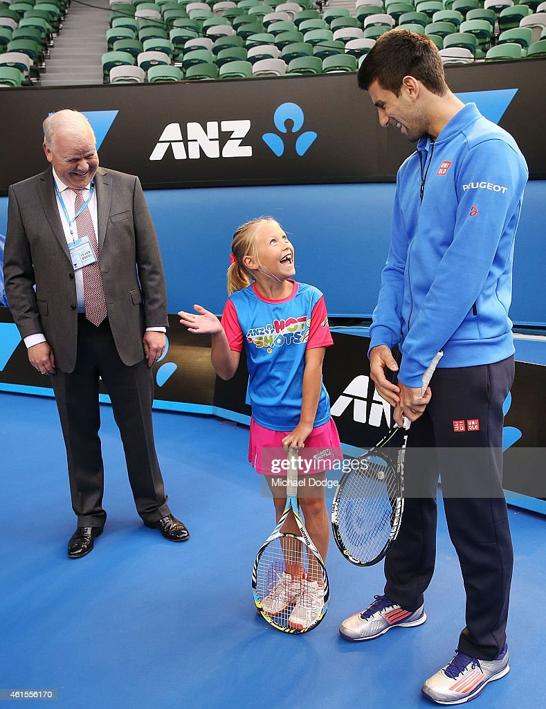 Novak Djokovic of Serbia makes a surprise appearance next ANZ Hot Shots winner Anna Bishop and ANZ CEO Mike Smith on Rod Laver Arena at Melbourne...