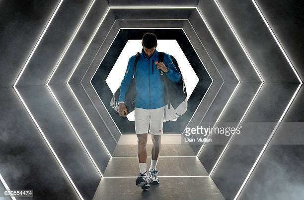Novak Djokovic of Serbia makes his way onto court for his Mens Singles second round match against Gilles Muller of Luxembourg on day three of the BNP...