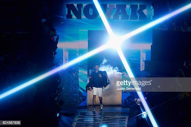 Novak Djokovic of Serbia makes his way to the court before his men's singles semi final against Kei Nishikori of Japan on day seven of the ATP World...