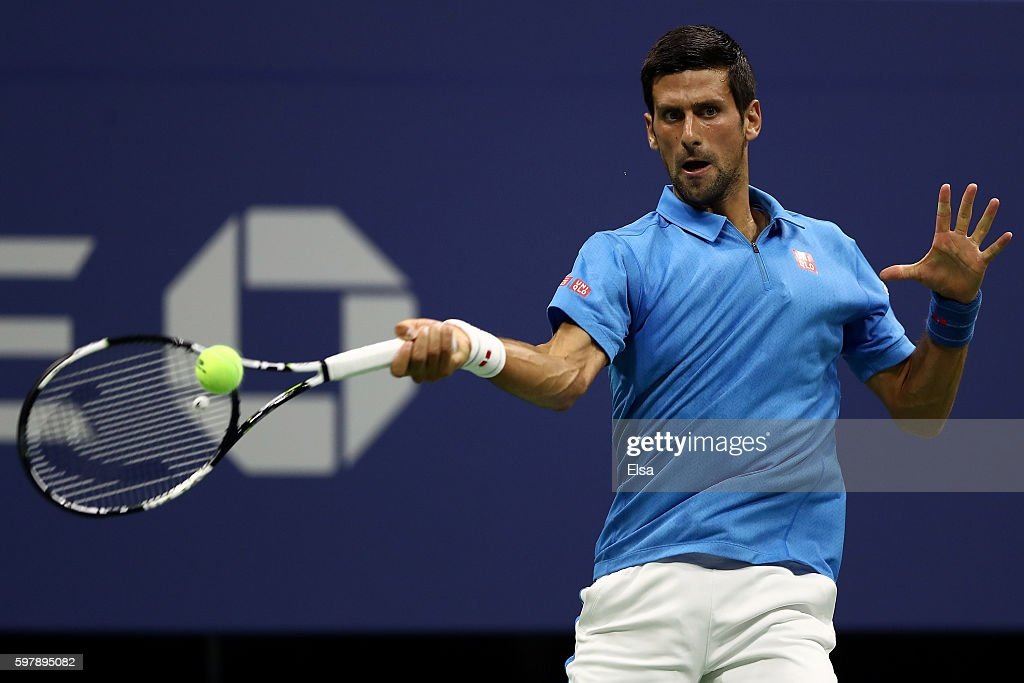 Novak Djokovic of Serbia Montenegro returns a shot to Jerzy Janowicz of Poland during his first round Men's Singles match on Day One of the 2016 US...