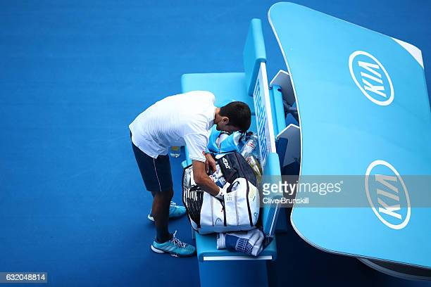 Novak Djokovic of Serbia packs his bag after losing his second round match against Denis Istomin of Uzbekistan on day four of the 2017 Australian...