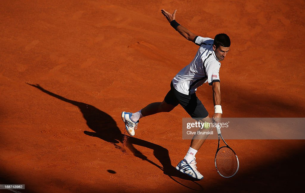 <a gi-track='captionPersonalityLinkClicked' href=/galleries/search?phrase=Novak+Djokovic&family=editorial&specificpeople=588315 ng-click='$event.stopPropagation()'>Novak Djokovic</a> of Serbia plays a backhand against Albert Montanes of Spain in their second round match during day three of the Internazionali BNL d'Italia 2013 at the Foro Italico Tennis Centre on May 14, 2013 in Rome, Italy.