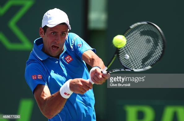 Novak Djokovic of Serbia plays a backhand against Andy Murray of Great Britain in the mens final during the Miami Open Presented by Itau at Crandon...