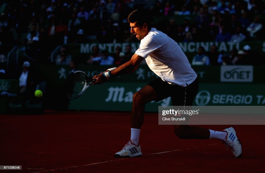 Novak Djokovic of Serbia plays a backhand against David Goffin of Belgium in their quarter final round match on day six of the Monte Carlo Rolex Masters at Monte-Carlo Sporting Club on April 21, 2017 in Monte-Carlo, Monaco.