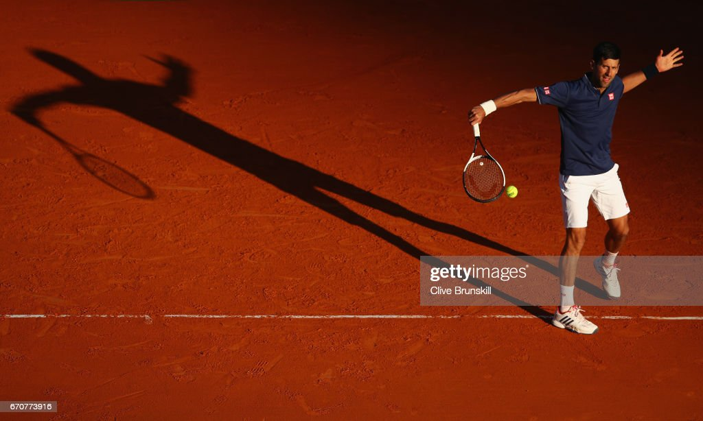 Novak Djokovic of Serbia plays a backhand against Pablo Carreno Busta of Spain in his third round match on day five of the Monte Carlo Rolex Masters at Monte-Carlo Sporting Club on April 20, 2017 in Monte-Carlo, Monaco.