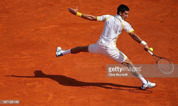 Novak Djokovic of Serbia plays a backhand against Rafael Nadal of Spain in their final match during day eight of the ATP Monte Carlo Mastersat...