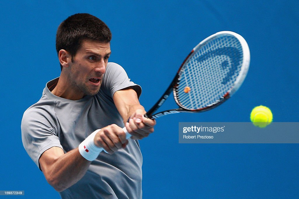 Novak Djokovic of Serbia plays a backhand ahead of the 2013 Australian Open at Melbourne Park on January 13, 2013 in Melbourne, Australia.