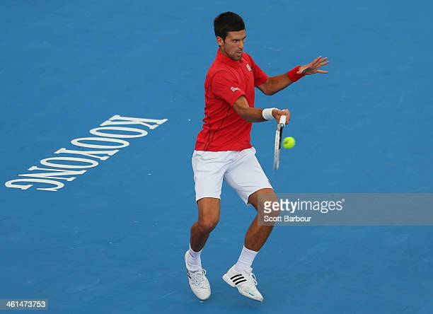 Novak Djokovic of Serbia plays a backhand during his match against Juan Monaco of Argentina during day two of the AAMI Classic at Kooyong on January...