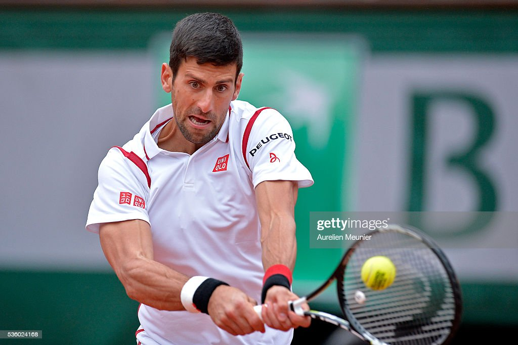 Novak Djokovic of Serbia plays a backhand during his men's singles fourth round match against Roberto Bautista Agut of Spain on day ten of the 2016 French Open at Roland Garros on May 31, 2016 in Paris, France.